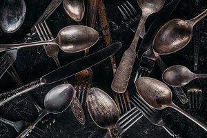 Vintage cutlery set on dark backgrou