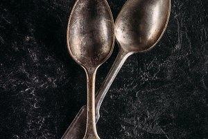 Vintage metal spoons on dark backgro