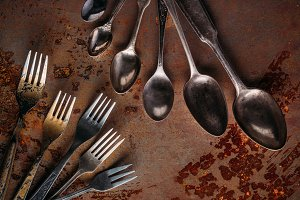 Vintage spoons and forks on rusted t