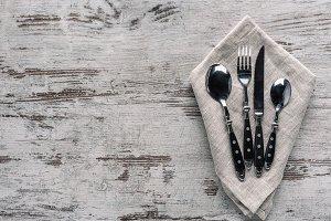 Set of dinner silverware with napkin
