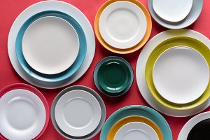 White and colorful plates of differe