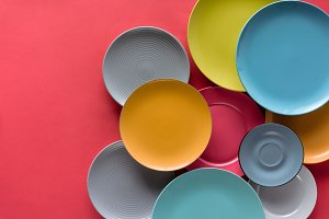 colorful plates composition on red b
