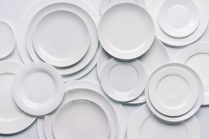 white plates composition on white ba
