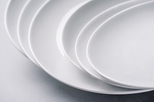 White ceramic plates stacked on whit