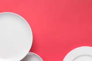 Composition of white plates on red b