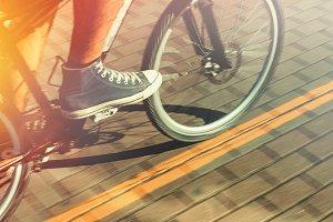 Unrecognizable Cyclist In Sneakers R