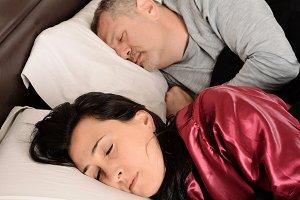 Middle age couple in sleeping togeth