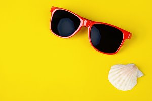 Fashionable sunglasses and shells wi