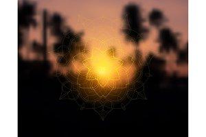 Shiny floral mandala on sunset