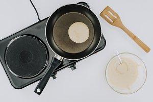 cropped shot of pancake cooking on f