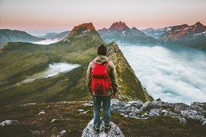 Hiker man exploring sunset mountains