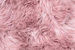 Sheep fur pink sheepskin rug backgro