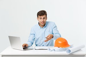 Handsome young man serious working