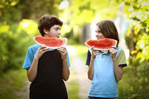 teenager boy with cut water melon cl