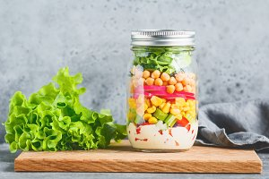 Single jar with layering vegan salad