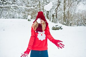 Blonde girl in red scarf, hat and sa