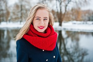 Portrai of blonde girl in red scarf