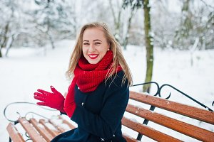 Blonde girl in red scarf and coat si