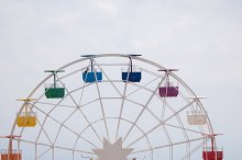 Ferris wheel on cloudy sky by  in Abstract