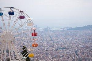 Ferris wheel on cloudy sky