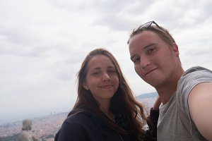 A young couple taking a selfie on