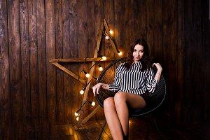 Girl posed against light star at stu