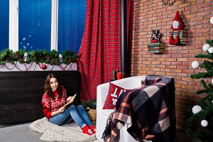 Girl wear on winter sweaters at room