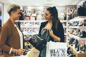 Couple of female shoppers on shoppin