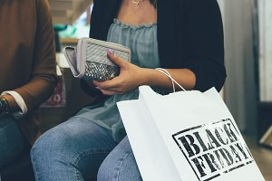 Female shopper paying