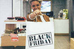 Young woman holds shopping bag