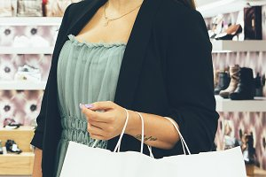 Young woman holds shopping bags
