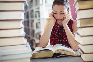 Attentive schoolgirl studying