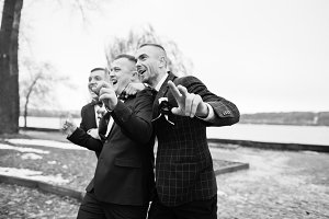 Groom with best mans at cold winter