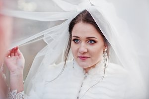 Blue eyes of cute bride under veil a
