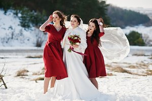 Pretty bridesmaids on red dresses wi