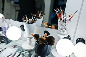 Various makeup brushes on table of b