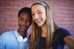 Portrait of happy schoolgirls