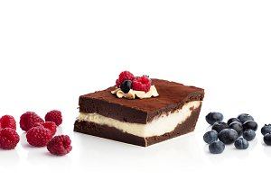 Piece of chocolate cake and fruits i