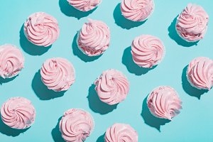 Pink cupcakes on blue background