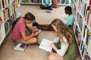 Attentive classmates studying