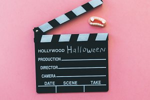 clapperboard and vampire fangs