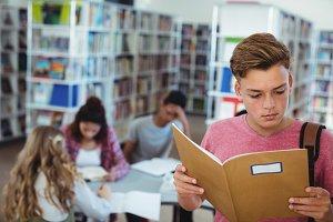 Schoolboy reading book