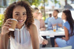 Smiling beautiful woman having coffe
