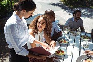 Waitress discussing the menu