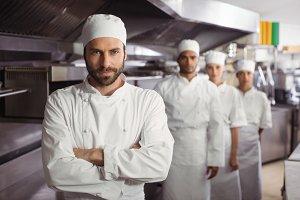 Happy chefs team standing