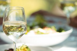 Close-up of food and wine glass