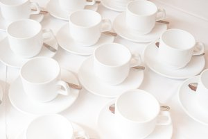 Group of white coffee cups in cafe