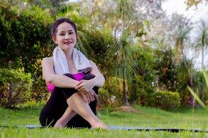 sport girl's sitting in the park
