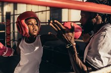 Kid learning boxing from his coach by  in Sports