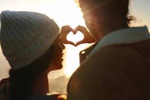 Romantic couple making heart